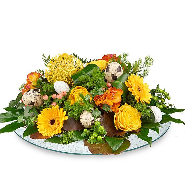 Paas bloemstuk geel oranje