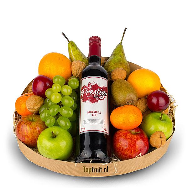 Fruitmand met rode wijn