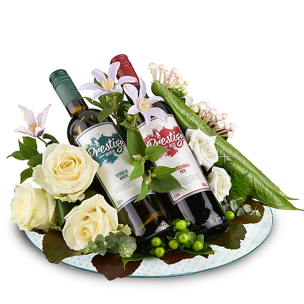 Flower arrangement with red and white prestige wine